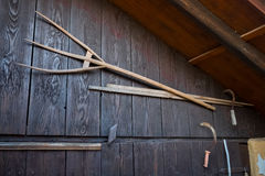 Ancient wooden pitchfork and sickles on old barn Royalty Free Stock Photos