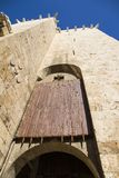 Ancient wooden rolling shutter gate at the entrance to the historical center of Cagliari in Italy. Ancient wooden rolling shutter gate with metal reinforcements royalty free stock photo