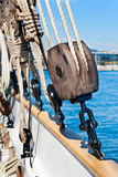 Ancient wooden sailboat pulley. And ropes detail Stock Photos