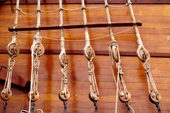 Ancient wooden sailboat pulleys and ropes. Detail stock photos