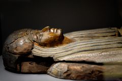 Ancient wooden sculpture of an Egyptian woman. Of rich noble family Royalty Free Stock Photo