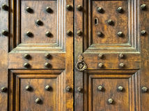 Ancient wooden spiked door detail in Florence, Italy (black and white) Royalty Free Stock Photos