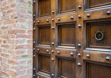 Ancient wooden spiked door details in Siena, Italy.  Stock Photo