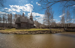 Ancient wooden temple stands on the banks of the river. Kostroma, Russia Royalty Free Stock Photos