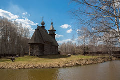 Ancient wooden temple stands on the banks of the river. Kostroma, Russia Royalty Free Stock Photo