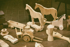 Ancient wooden toys. Antique handmade wooden toys vintage stock photos