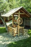Ancient wooden well. summer sunny day. Ukrainian Folk Museum Stock Photography