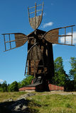 Ancient wooden windmill against the blue sky Royalty Free Stock Images