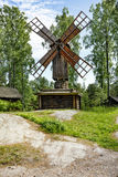 Ancient wooden windmill in forest royalty free stock image