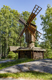 Ancient wooden windmill in forest stock images