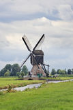 Ancient wooden windmill near small canal, Kinderdijk, Netherlands Stock Image