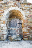 Ancient wooden window of medieval brick wall Stock Photos