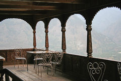Ancient fort woodwork  in remote valley view in Indian Himalaya