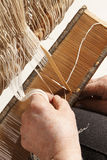 An ancient work. A people work on a handloom royalty free stock images