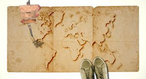 Ancient world map with blank wooden sign and sneakers. Travel concept. Royalty Free Stock Photos