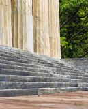 Ancient worn stone steps and columns of this ancient stone building Royalty Free Stock Photos