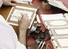 Ancient writing. Writing old, old man writing with typography, traditional art Stock Images