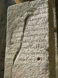 Ancient writing. Its photo of ancient writing written on one of the pillars at Ancient cave temple. Place - Kanheri caves, Mumbai, India royalty free stock photography
