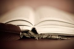 Ancient writings and ancient pens. Pages, books, diaries, all on paper sheets royalty free stock images