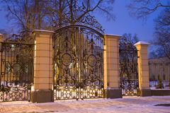 The ancient wrought-iron gates of the palace of Grand Duke Alexander Mikhailovich in the January evening, Saint Petersburg Stock Photos