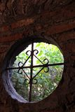 Ancient wrought iron round window Stock Image