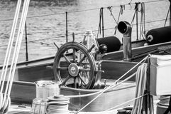 Ancient yacht deck with wooden wheel Royalty Free Stock Image