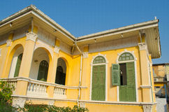 Ancient yellow house - outside second floor view 1 Royalty Free Stock Image