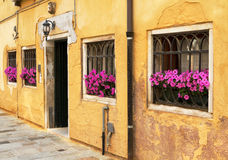 Ancient yellow stone house in Italy. Stock Photo