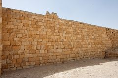 Ancient yellow stone wall Stock Image