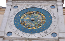 Ancient Zodiacal Astronimical Clock in the Piazza dei Signori in stock photography