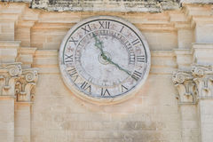 The ancients clock on old building Royalty Free Stock Photography