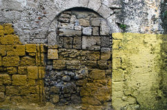 Anciet ruined painted wall background, Rhodes,Greece Royalty Free Stock Photo