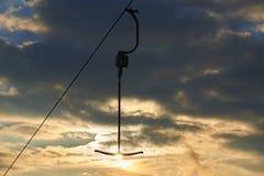 Ancre de remonte-pente au coucher du soleil Image stock