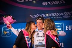 Andalo, Italia 24 de mayo de 2016; Bob Jungels en el jersey blanco en el podio después de acabar la etapa Foto de archivo libre de regalías