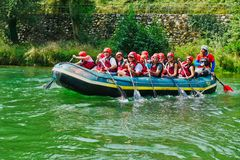 People having fun rafting in the river. Andalo, Italy - August 2018: People having fun rafting in the river stock photography