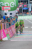Andalo, Italy May 24, 2016; A group of professional cyclists passes the finish line of the stage. Stock Photography
