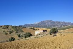 Andalucian landscape with plowed fields and barn Royalty Free Stock Photography