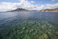 Andalusia coast and mediterranean. Looking across La Isleta bay in Cabo de Gata National Park, Andalusia, Spain towards the volcanic mountains and the coast Stock Photos