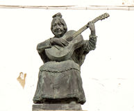 Andalusia musician. Music occupies a great place in Andalusia, Spain. Here, a statue near public fountain at Ronda to illustrate this Royalty Free Stock Images