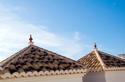 Andalusian architecture. Roof with tiles in andalusian style against the sky royalty free stock photography
