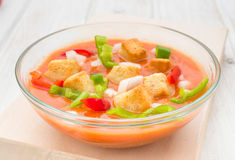 Andalusian gazpacho soup with vegetables and croutons in round b. Andalusian gazpacho soup with vegetables and croutons in round glass bowl Stock Photo