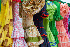 Andalusian gipsy dresses in a row at Spain Royalty Free Stock Images