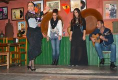 Andalusian girls dance and sing flamenco, the typical traditional music of southern Spain, Seville, 04/15/2017. Dancing and singing Flamenco in a bar in Sevilla stock photos