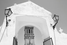 Andalusian traditional facade and arch with lamps. Spain Stock Image