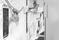 Andalusian traditional street with white wall. Spain Royalty Free Stock Photography