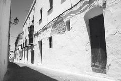 Andalusian traditional street with white walls. Spain Royalty Free Stock Photo
