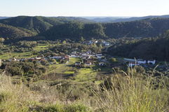 Andalusian village. Tranquil Andalusian white village with mountains, trees, in the background Stock Image