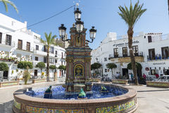 Andalusian village, Spain. Vejer de la Frontera, Spain - August 27, 2014: Central square of the town of Vejer de la Frontera and its splendid source, a small Stock Photography
