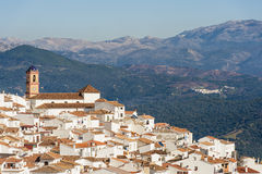 Andalusian village on sunny winterday. Village of Algatocin, Andalusia, Spain against a backdrop of mountains. Captured on a sunny winterday in december Royalty Free Stock Photo