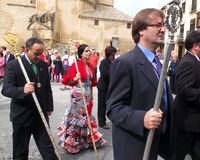 Andalusian, wearing a red dress, parades. Royalty Free Stock Photography